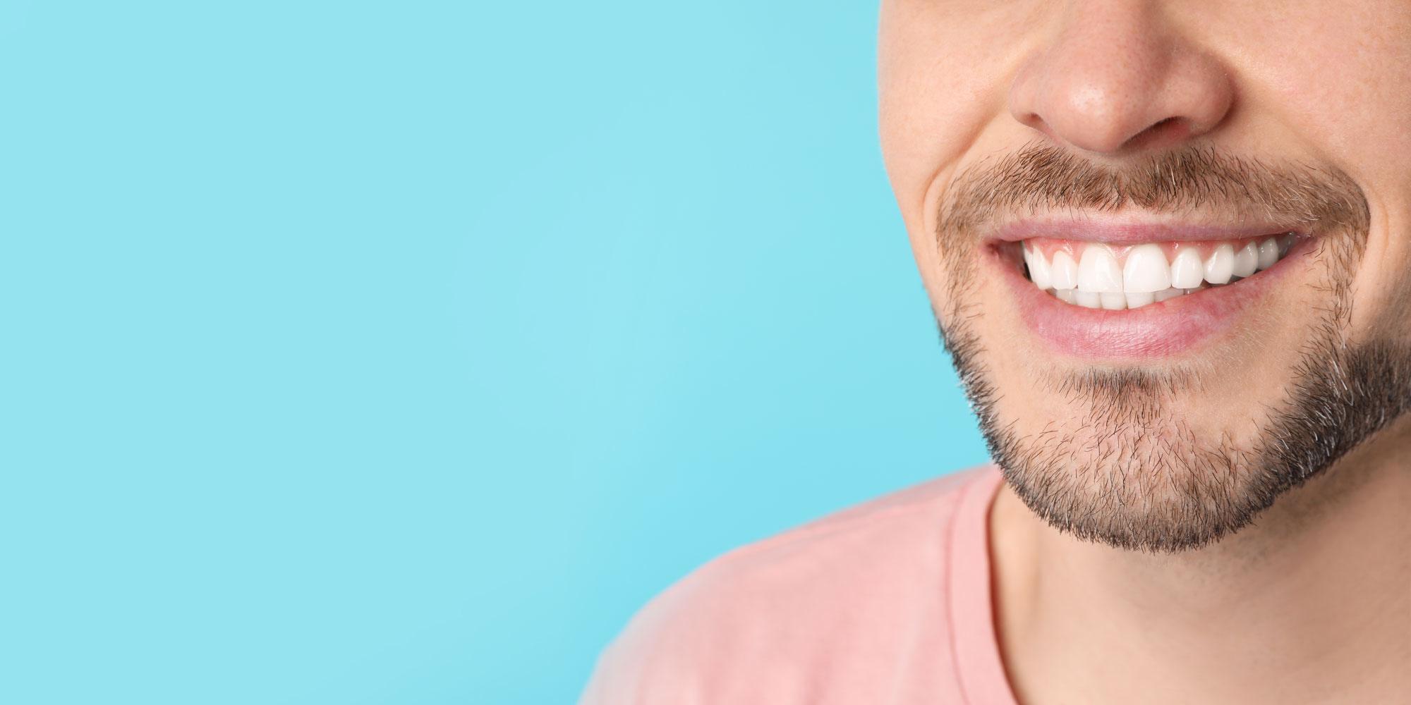 patient smiling after dental crowns procedure
