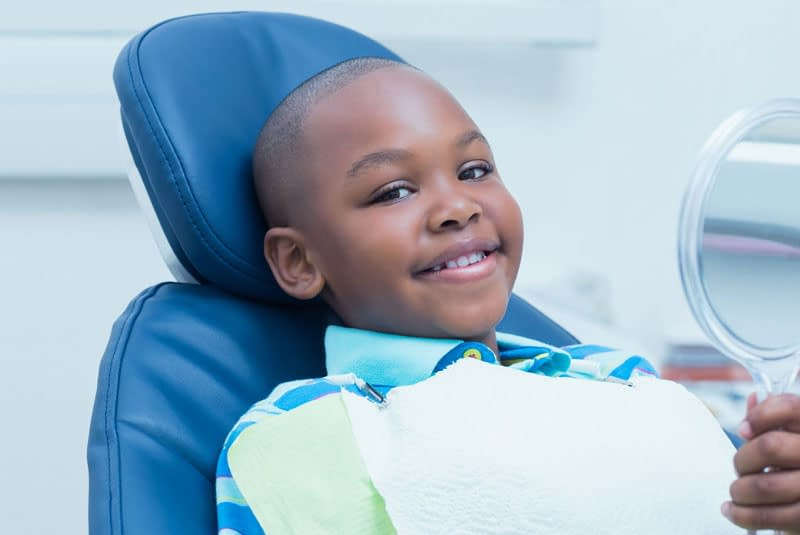 young dental patient smiling after procedure